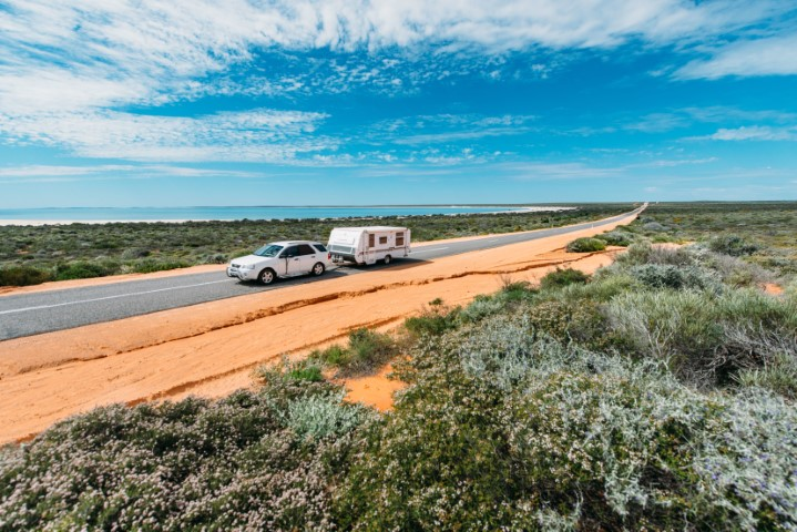Car towing a caravan along the Shark Bay World Heritage Drive. Shark bay World Heritage Area.